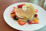 Hotcakes with Banana Berries and Honey
