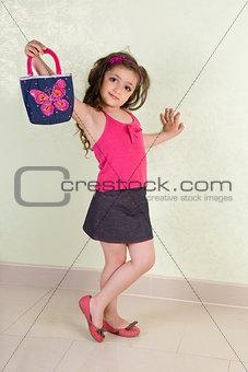 small girl with bag