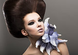 Extravagance. Classy Woman with Lily. Stylish Hairdo. Luxury