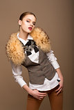 Portrait of Perfect Arrogant Woman in Grey Waistcoat and Fur Collar