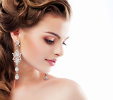 Pure Beauty. Aristocratic Profile of smiling Lady with Glossy Diamond Earrings. Femininity & Sophistication