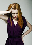 Sadness. Unhappy Woman holding her Red Head with hand in Stress. Depression