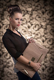 fashion brunette with bag turned of three quarters