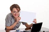 Smiling business woman holding white board