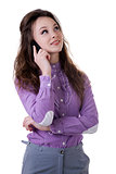 Smiling girl with a cellphone in her hands looking up isolated o