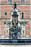 Statues on the fountain at the entrance to Frederiksborg Castle,