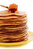 Stack of pancakes and a spoon with red caviar.