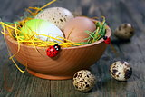 Easter eggs in a wooden bowl.