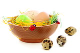 Colorful Easter eggs in wooden bowl.
