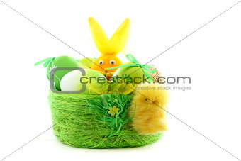 Green basket with Easter eggs.
