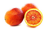 Full and half of blood red oranges.
