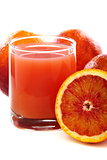 Glass with juice and blood oranges.