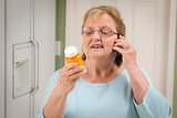 Senior Adult Woman on Cell Phone Holding Prescription Bottle