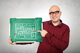 Man with labyrinth on chalkboard