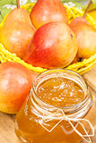 Pear jam in a glass jar and fresh fruits