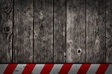 wooden background with warning bar