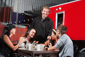 Canteen Owner with Happy Diners