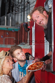Chef with Pizza at Food Truck