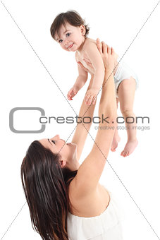 Attractive mother raising her baby and laughing