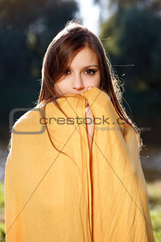 young beautiful woman hiding her face