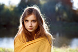 young beautiful woman wrapped herself up in a scarf