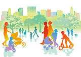 Families with children are walking in the park