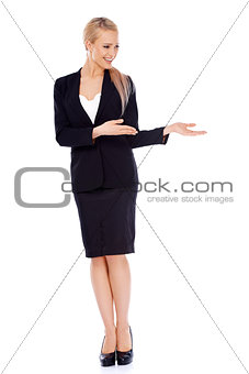 Beautiful blond business woman presenting copy space