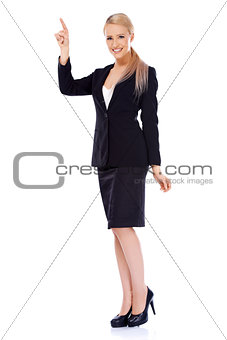 Smiling blond business woman pointing at copy space