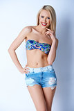 Blond sexy woman in short jeans and bikini bra