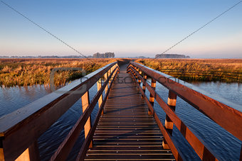 wooden bridge through canal