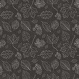 Vintage black background with tree leaves hand drawn silhouettes. Seamless pattern
