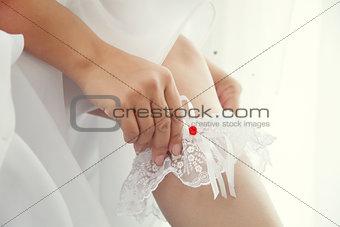 Bride dress up a white garter