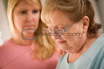 Young Woman Consoles Senior Adult Female