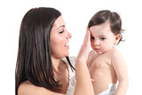 Attractive mother combing her baby