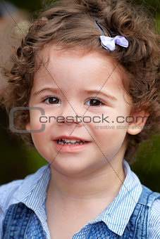 Baby girl portrait outdoor in spring