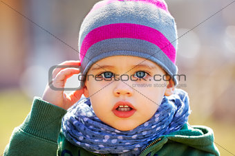 Baby boy portrait outdoor in spring