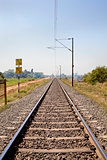 Indian railroad track through coutryside