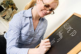 Teacher Writes a Message on ChalkBoard Saying Welcome to Biology