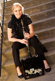 Female Street Performer Sits on Steps Clarinet Case With Tips
