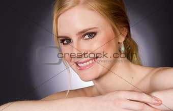 Beautiful Blond Smiling Big in Head and Shoulders Beauty Pose