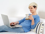 Pretty female sitting with laptop