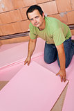 Laying insulation layer on the floor