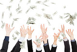 Many dollars falling on business people hand