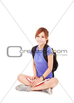 beautiful student girl reading book and sitting on floor