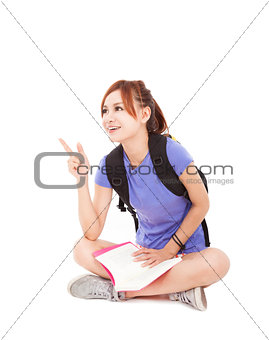student girl reading book and pointing at something