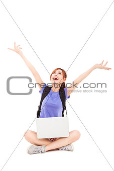 happy young Woman sitting with laptop and looking up
