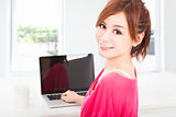smiling young woman sitting with laptop computer 