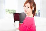 happy asian woman sitting with laptop computer 