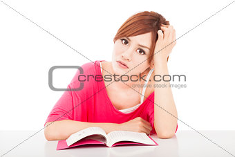 embarrassed school girl studying with book