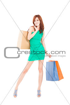 young slim woman with shopping bags